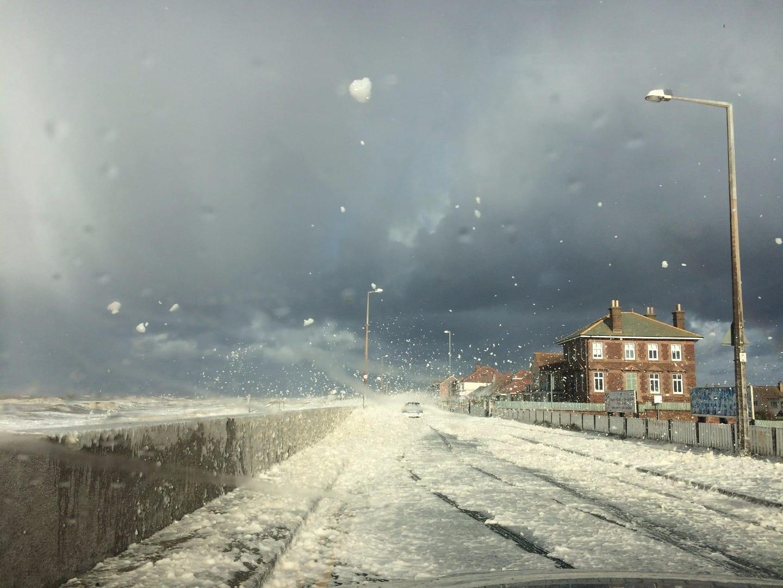 Sea foam at Cleveleys on North Promenade