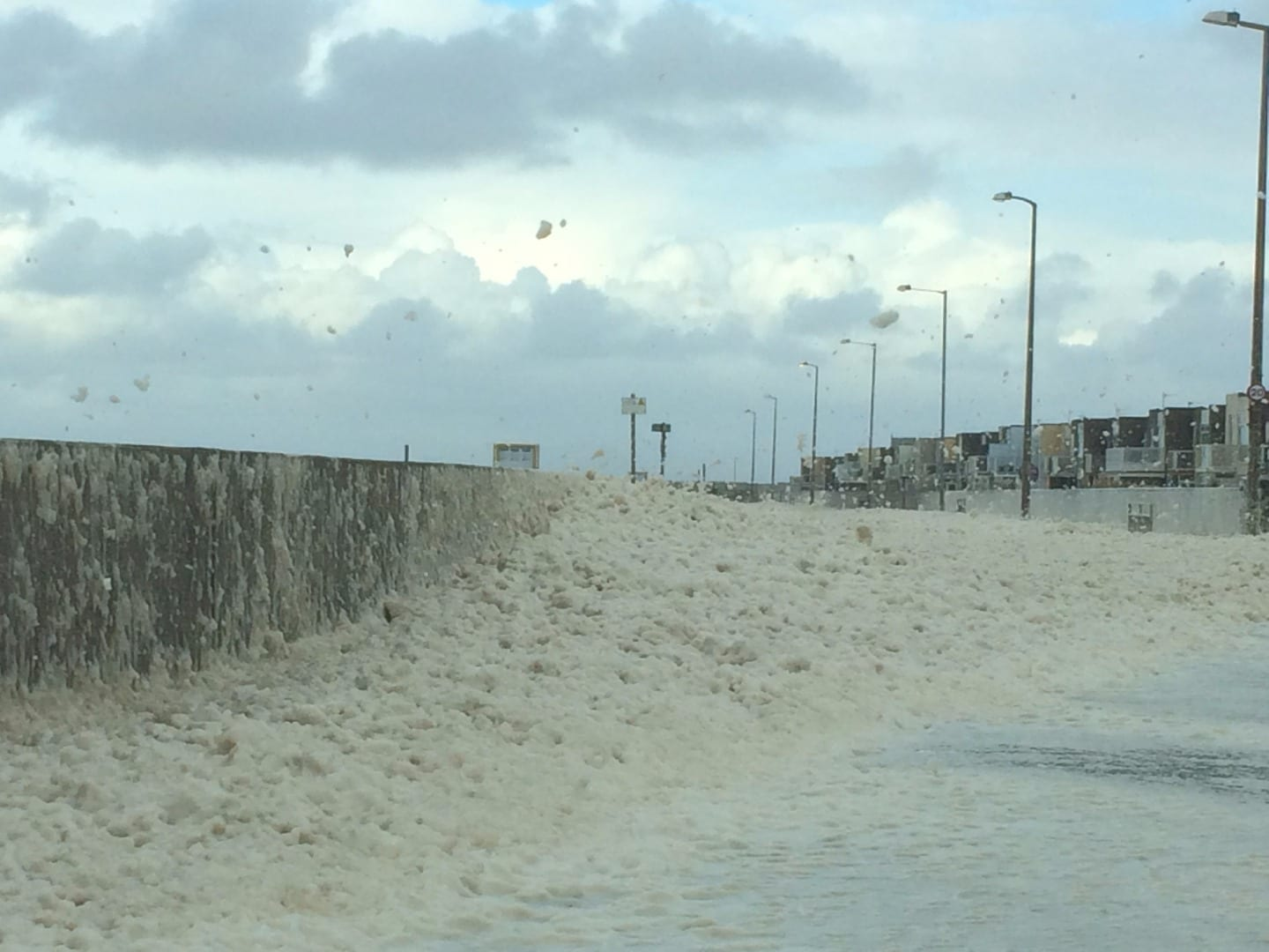 Sea foam piled up on Rossall Promenade at Cleveleys