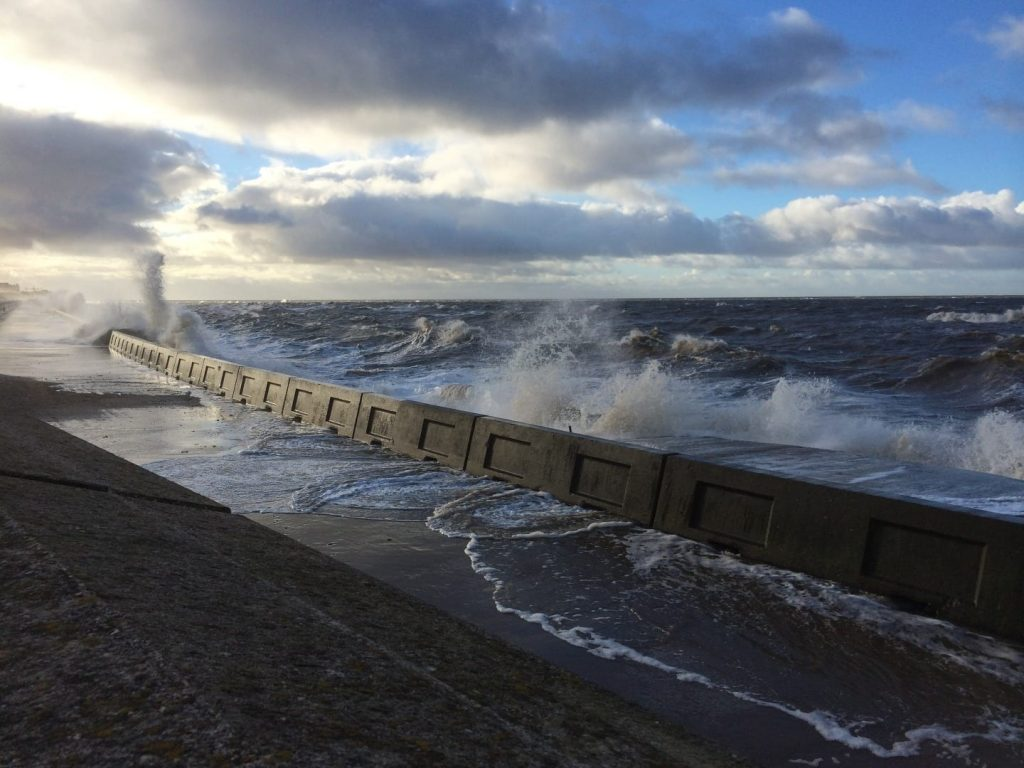 Waves overtopping the lower seawall at Blackpool seafront at Anchorsholme, on the Fylde Coast seafront
