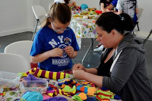 Making sock puppets at relaunch weekend when Freeport Fleetwood changed its name to Affinity Lancashire