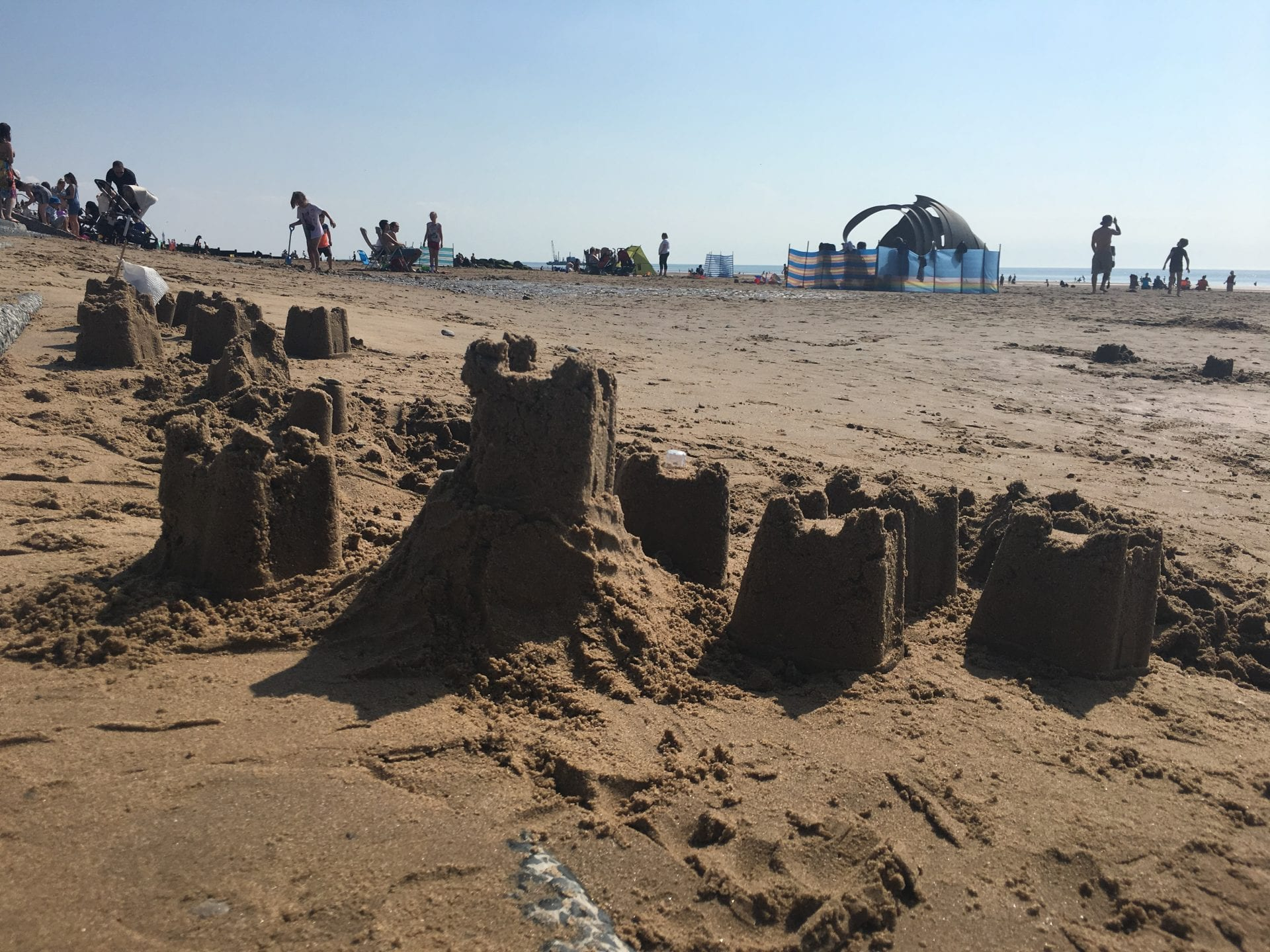 Sandcastles on Cleveleys Beach in beautiful weather on Bank Holiday Monday