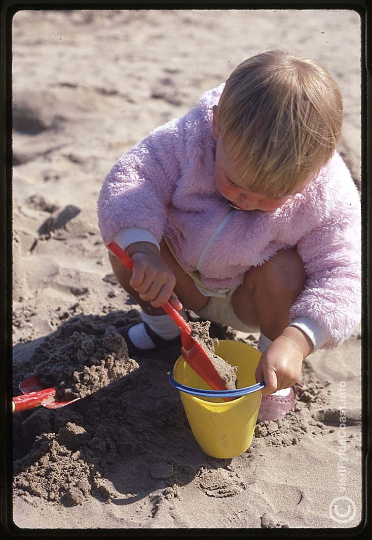 Jane on the beach building sandcastles on her first holiday in Blackpool
